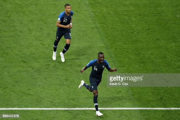 Kylian Mbappe and Blaise Matuidi of France celebrate after Mario Mandzukic of Croatia scores an own goal for France's first goal during the 2018 FIFA...