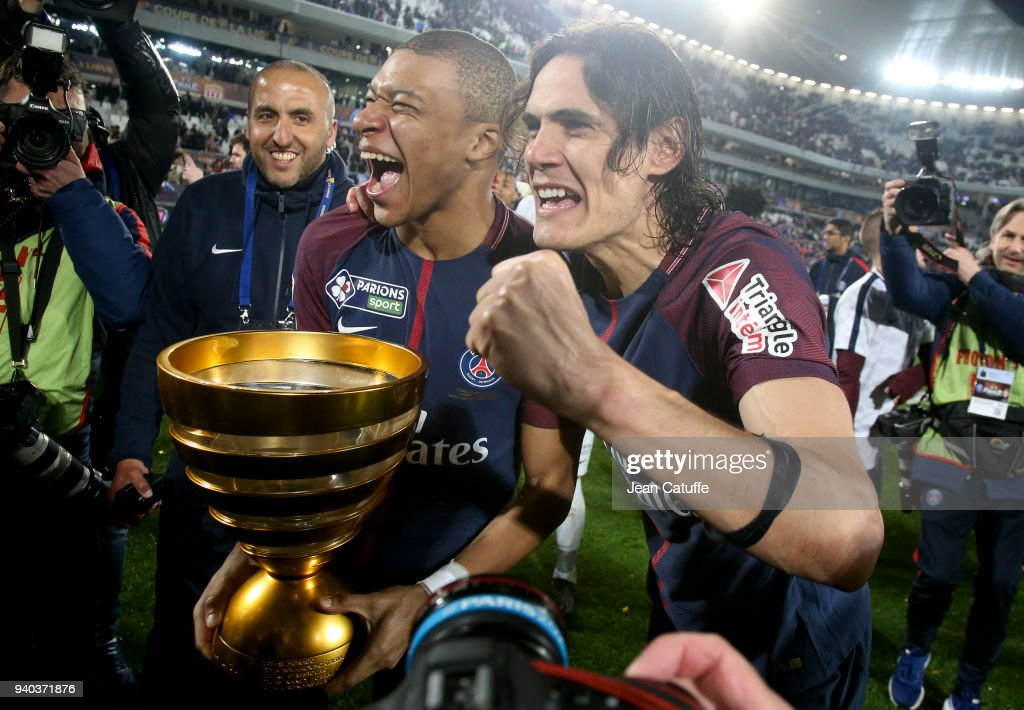 Kylian Mbappe and Edinson Cavani of PSG celebrate the victory following the French League Cup (Coupe de la Ligue) final between Paris Saint-Germain (PSG) and AS Monaco on March 31, 2018 in Bordeaux, France.