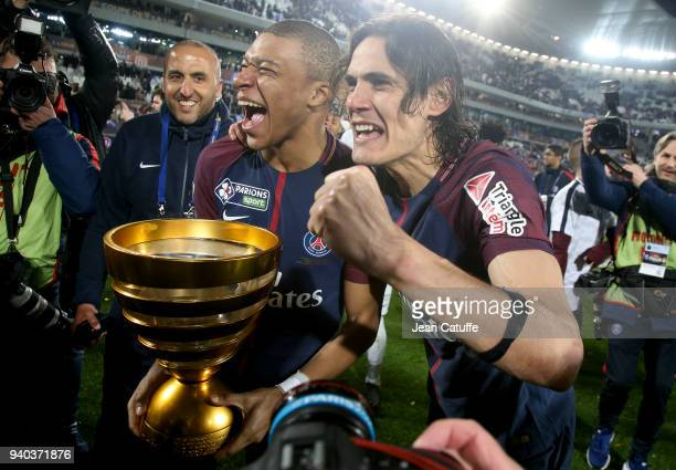 Kylian Mbappe and Edinson Cavani of PSG celebrate the victory following the French League Cup final between Paris SaintGermain and AS Monaco on March...