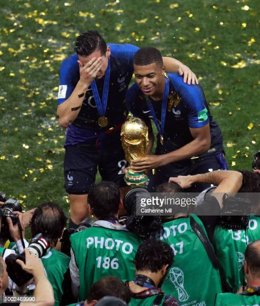 Kylian Mbappe and Florian Thauvin of France with the trophy after the 2018 FIFA World Cup Russia Final between France and Croatia at Luzhniki Stadium...