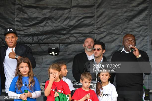 Kylian Mbappe and his father Wilfried Mbappe during the return of UEFA Soccer World Champion Kylian Mbappe to his hometown Bondy to celebrate the...