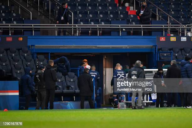 Kylian Mbappe and Mitchel Bakker of Paris Saint-Germain leave the field during the confusion following an alleged incident between Istanbul...