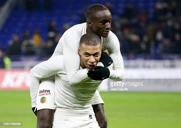 Kylian Mbappe and Moussa Diaby of PSG celebrate the victory following the French Cup match between FC Villefranche Beaujolais and Paris SaintGermain...