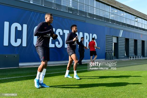 Kylian Mbappe and Neymar Jr arrive to a Paris SaintGermain training session at Ooredoo Center on August 21 2019 in Paris France