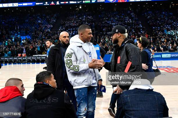 Kylian Mbappe and Neymar Jr of Paris SaintGermain attend the NBA match between the Milwaukee Bucks and the Charlotte hornets at AccorHotels Arena on...