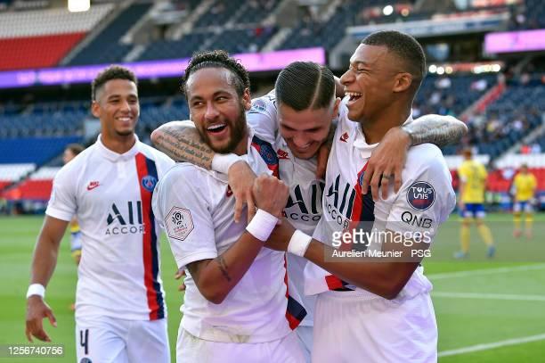 Kylian Mbappe and Neymar Jr of Paris Saint-Germain congratulate teammate Mauro Icardi after he scored during the Friendly match between Paris...