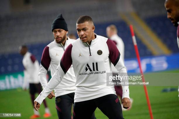 Kylian Mbappe and Neymar Jr of Paris SaintGermain in action during a training session ahead of the UEFA Champions League Group H stage match between...