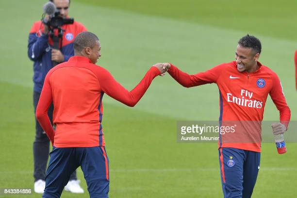 Kylian Mbappe and Neymar Jr of Paris SaintGermain shake hands before a Paris SaintGermain training session at Centre Ooredoo on September 6 2017 in...