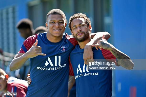 Kylian Mbappe and Neymar Jr pose together before a Paris Saint-Germain training session at Ooredoo Center on July 13, 2020 in Paris, France.