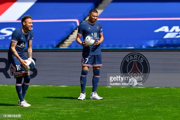 Kylian Mbappe and Neymar Jr react as the Paris Saint-Germain unveils the new Jordan kit on May 17, 2021 in Paris, France.