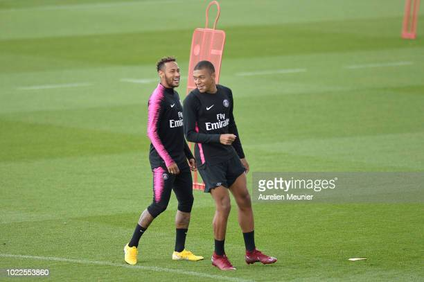 Kylian Mbappe and Neymar Jr react during a Paris SaintGermain training session at Ooredoo Center on August 24 2018 in Paris France