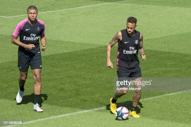 Kylian Mbappe and Neymar Jr warm up during a Paris SaintGermain training session at Ooredoo Center on August 11 2018 in Paris France