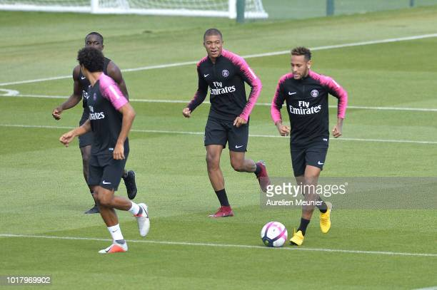 Kylian Mbappe and Neymar Jr warm up during a Paris SaintGermain training session at Ooredoo center on August 17 2018 in Paris France