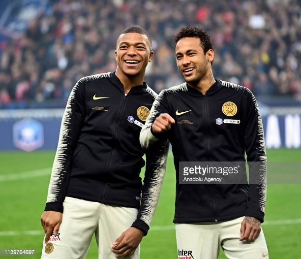 Kylian Mbappe and Neymar of Paris SaintGermain gesture before the French Cup final match between Stade Rennais and Paris SaintGermain at Stade de...
