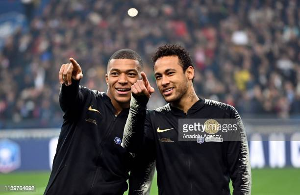 Kylian Mbappe and Neymar of Paris SaintGermain point fingers before the French Cup final match between Stade Rennais and Paris SaintGermain at Stade...