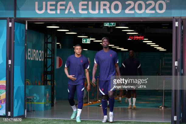 Kylian Mbappe and Paul Pogba of France take to the field during the France Training Session ahead of the UEFA Euro 2020 Championship Group F match...