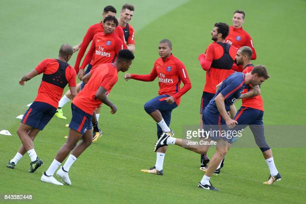 Kylian Mbappe and teammates warm up during Paris Saint Germain training session at Centre Ooredoo training camp on September 6 2017 in...