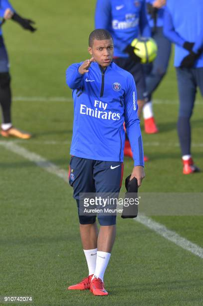Kylian Mbappe arrives for a training session of Paris Saint Germain PSG at Camp des Loges on January 26 2018 in Paris France