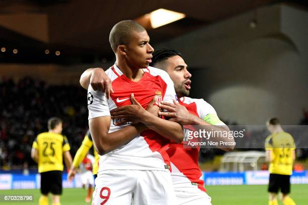 Kylian Mbappe celebrates his goal with Radamel Falcao of Monaco during the Uefa Champions League quarter final second leg match between As Monaco and...