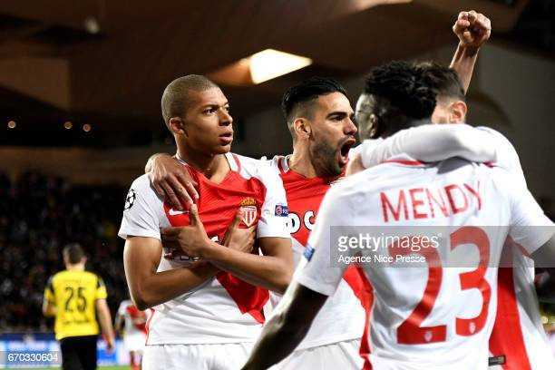 Kylian Mbappe celebrates his goal with teammates of Monaco during the Uefa Champions League quarter final second leg match between As Monaco and...