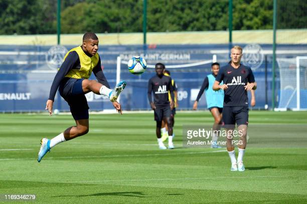 Kylian Mbappe controls the ball during a Paris SaintGermain training session at Ooredoo Center on August 21 2019 in Paris France