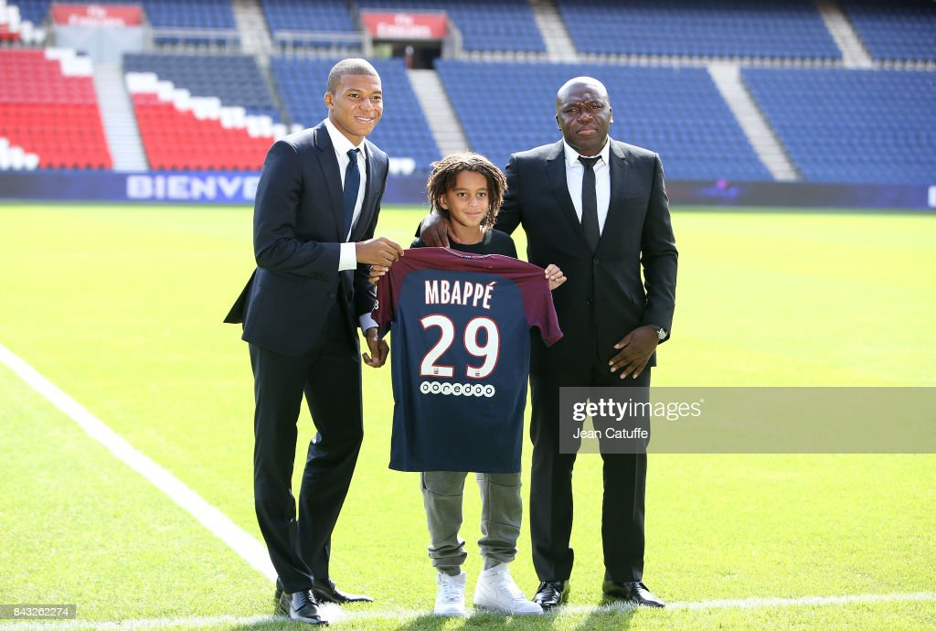 Kylian Mbappe - here with his little brother Ethan Mbappe (born a december 29, reason of Kylian's jersey number) and his father Wilfried Mbappe - is presented as new player of Paris Saint Germain at Parc des Princes on September 6, 2017 in Paris, France.