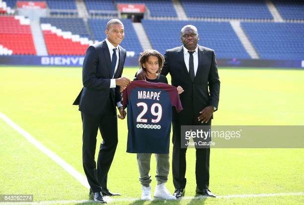 Kylian Mbappe here with his little brother Ethan Mbappe and his father Wilfried Mbappe is presented as new player of Paris Saint Germain at Parc des...
