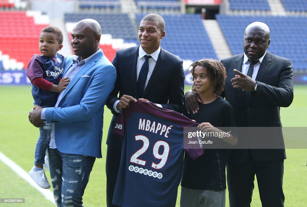 Kylian Mbappe - here with his uncle Pierre Mbappe, his little brother Ethan Mbappe (born a december 29, reason of Kylian's jersey number) and his father Wilfried Mbappe - is presented as new player of Paris Saint Germain at Parc des Princes on September 6, 2017 in Paris, France.