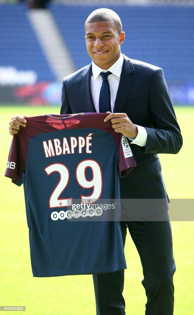 Kylian Mbappe is presented as new player of Paris Saint Germain by President of PSG Nasser Al Khelaifi at Parc des Princes on September 6, 2017 in Paris, France.