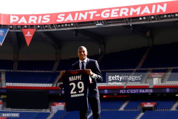 Kylian Mbappe is presented as new player of Paris Saint Germain by President of PSG Nasser Al Khelaifi at Parc des Princes on September 6 2017 in...
