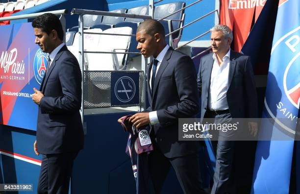 Kylian Mbappe is presented as new player of Paris Saint Germain by President of PSG Nasser Al Khelaifi followed here by Director of Communications...