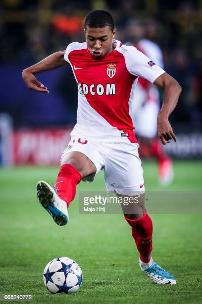 Kylian Mbappe Lottin of Monaco controls the ball during the UEFA Champions League Quarter Final first leg match between Borussia Dortmund and AS...