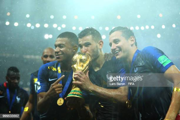 Kylian Mbappe Lucas Hernandez and Florian Thauvin of France celebrate victory following the 2018 FIFA World Cup Final between France and Croatia at...
