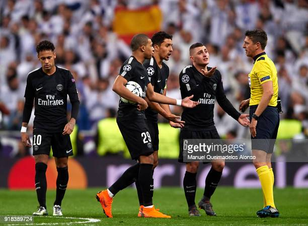 Kylian Mbappe Marquinhos and Marco Verrati of Paris SaintGermain argue with referee Gianluca Rocchi during the UEFA Champions League Round of 16...