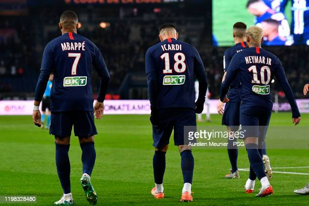 Kylian Mbappe Mauro Icardi and Neymar Jr of Paris SaintGermain walk back to the center of the pitch during the Ligue Cup quarter final match between...