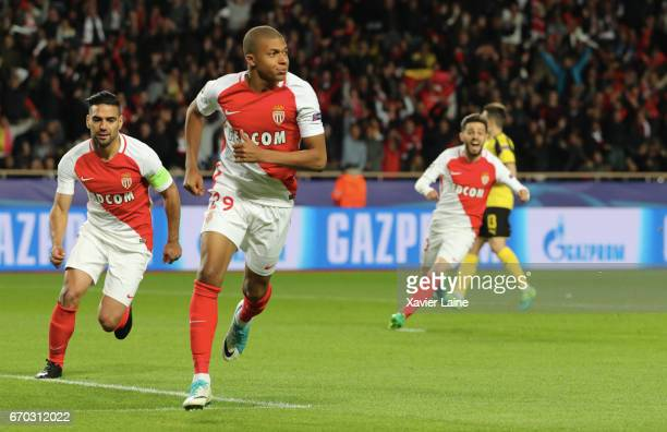 Kylian Mbappe of AS Monaco celebrates his goal with teammattes during the UEFA Champions League Quarter Final second leg between AS Monaco and...