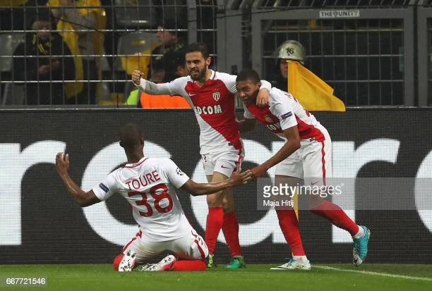 Kylian Mbappe of AS Monaco celebrates scoring the opening goal with team mates during the UEFA Champions League Quarter Final first leg match between...