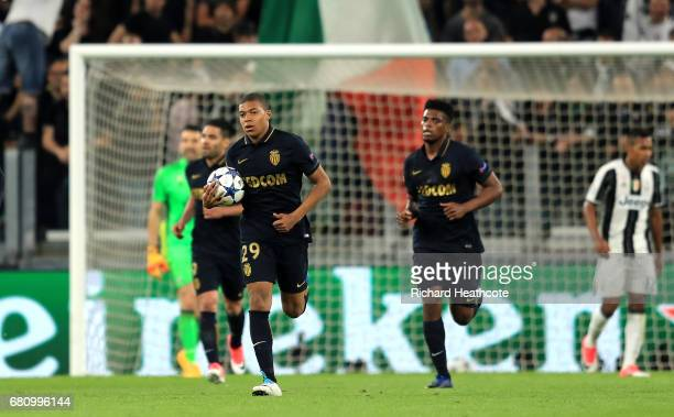 Kylian Mbappe of AS Monaco runs back to the half way line after scoring his sides first goal during the UEFA Champions League Semi Final second leg...