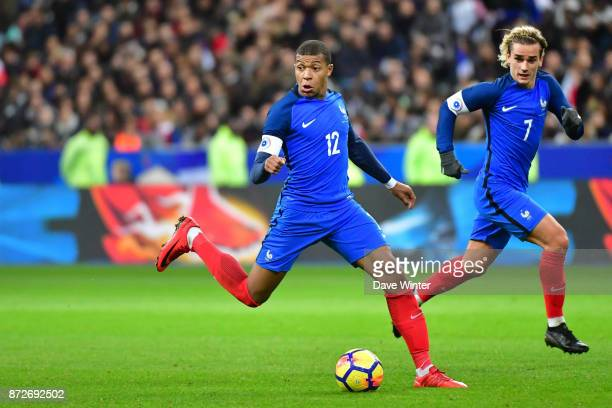 Kylian Mbappe of France and Antoine Griezmann of France during the international friendly match between France and Wales at Stade de France on...