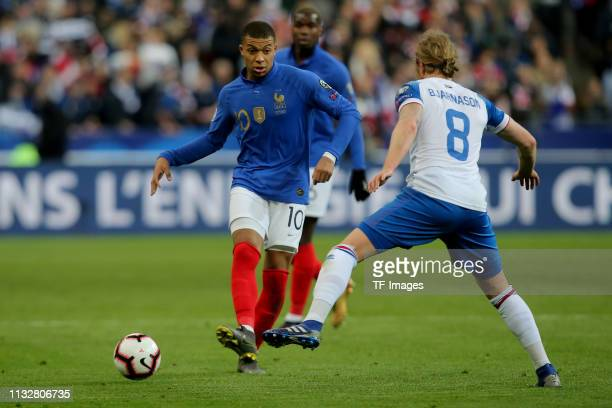 Kylian Mbappe of France and Birkir Bjamason of Iceland battle for the ball during the 2020 UEFA European Championships group H qualifying match...