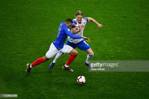 Kylian Mbappe of France and Birkir Bjarnason of Iceland during the European Championship 2020 qualifying match between France and Iceland at Stade de...
