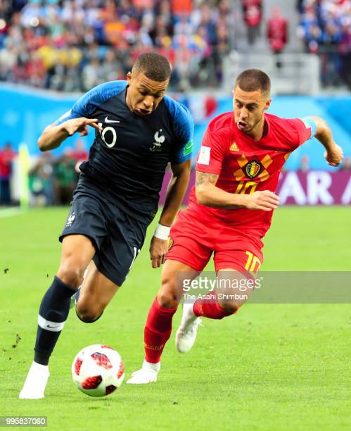 Kylian Mbappe of France and Eden Hazard of Belgium compete for the ball during the 2018 FIFA World Cup Russia Semi Final match between Belgium and...