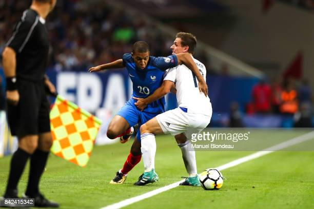 Kylian Mbappe of France and Mathias Janisch of Luxembourg during the Fifa 2018 World Cup qualifying match between France and Luxembourg at on...