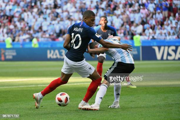 Kylian Mbappe of France and Nicolas TAGLIAFICO of Argentina during the FIFA World Cup Round of 16 match between France and Argentina at Kazan Arena...