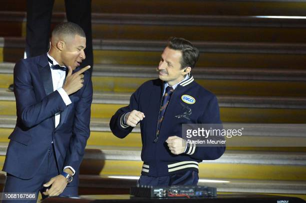 Kylian Mbappe of France and Paris SaintGermain dances with French DJ Martin Solveig after he won the Kopa Trophy for best young player at the Ballon...