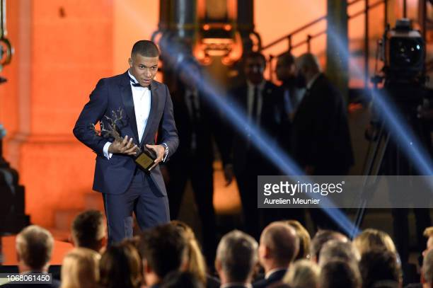 Kylian Mbappe of France and Paris SaintGermain wins the Kopa Trophy for best young player at the Ballon D'Or ceremony at Le Grand Palais on December...