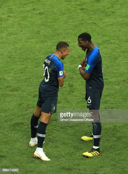 Kylian Mbappe of France and Paul Pogba of France celebrate the fourth goal during the 2018 FIFA World Cup Russia Final between France and Croatia at...