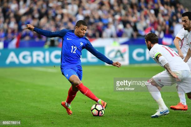 Kylian Mbappe of France and Sergio Ramos of Spain during the friendly match between France and Spain at Stade de France on March 28, 2017 in Paris,...