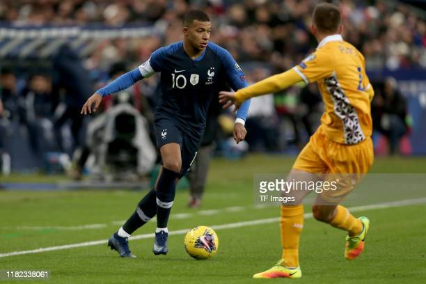 Kylian Mbappe of France and Sergiu Platica of Moldova battle for the ball during the UEFA Euro 2020 Qualifier between France and Moldova on November...