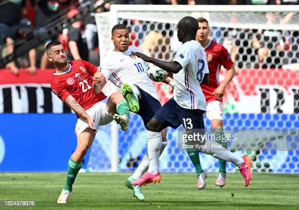 Kylian Mbappe of France battles for possession with Endre Botka of Hungary during the UEFA Euro 2020 Championship Group F match between Hungary and...